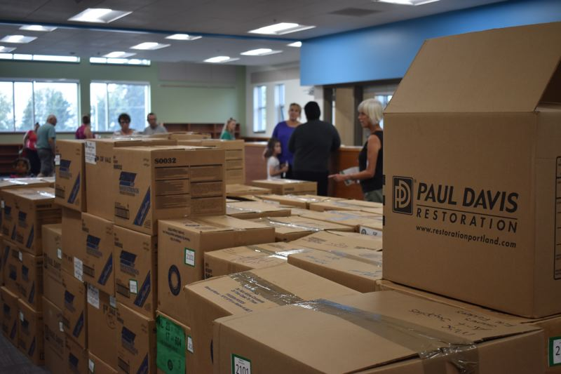 OUTLOOK PHOTO: TERESA CARSON - Library books at Wilkes Elementary are boxed up and ready to go into shelves in the new media center.