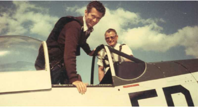 SUBMITTED PHOTO - Jack Erickson, in foreground, gets into his P-51 Mustang in the early 1980s, with Norman 'Swede' Ralston, the former owner of Aero Air, in the background.