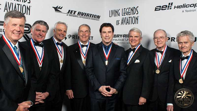 SUBMITTED PHOTO - The 'Living Legends of Aviation' presentation of 2014 included Jack Erickson, far right, presenter John Travolta, fourth from right, and actor Treat Williams, second from left.