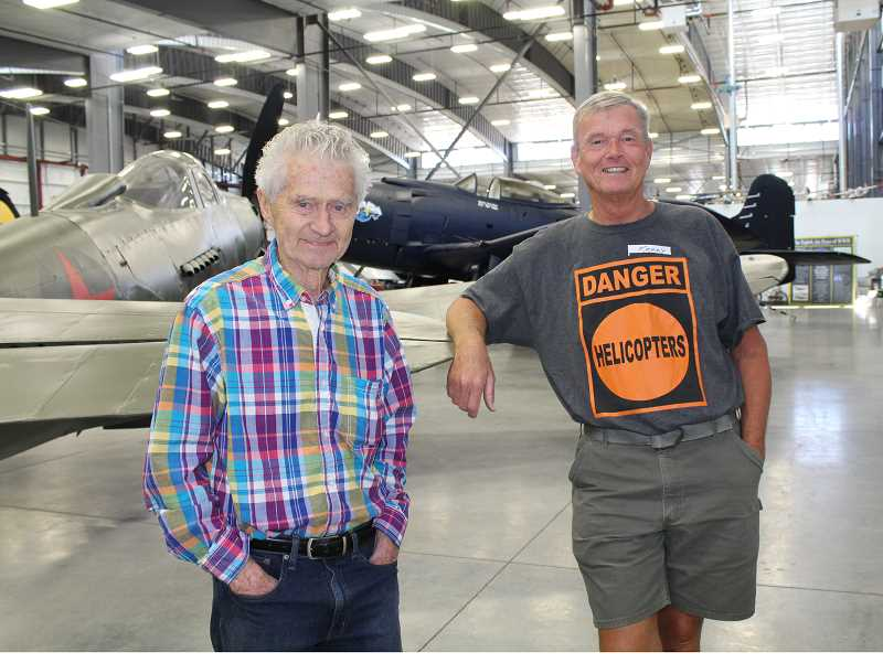 HOLLY M. GILL/MADRAS PIONEER - On May 7, the Erickson Aircraft Collection hosted a gathering of about 185 heli-loggers from around the Northwest. Erickson and Kenny Chapman, who piloted a famous Erickson Air-Crane named 'Elvis' during a long career with the company, reminisce.