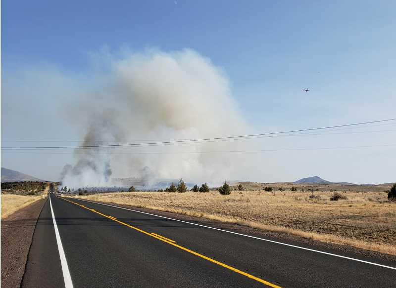 PHOTO COURTESY OF JEFFERSON COUNTY SHERIFF'S OFFICE - The Mile Post 6 fire took off Friday, Aug. 17, along U.S. Highway 26, on the Crooked River National Grassland. The highway was closed for several hours Friday evening, as a result of the fire.