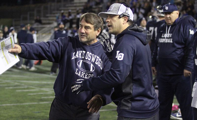 REVIEW FILE PHOTO - Lake Oswego football coach Steve Coury (left) is one of many Class 6A coaches from across the state who is not thrilled with the new, truncated league schedule that teams will play this fall.