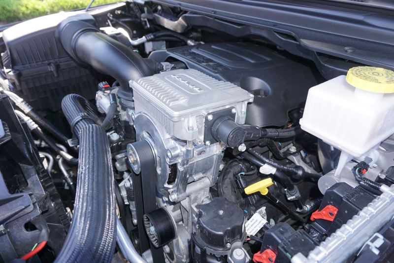 PORTLAND TRIBUNE: JEFF ZURSCHMEIDE - An electric motor/generator literally sits on top of the regular 3.6-liter Pentastar V6 or 5.7-liter HEMI V8 engine, and it helps drive the engine using a heavy-duty belt.