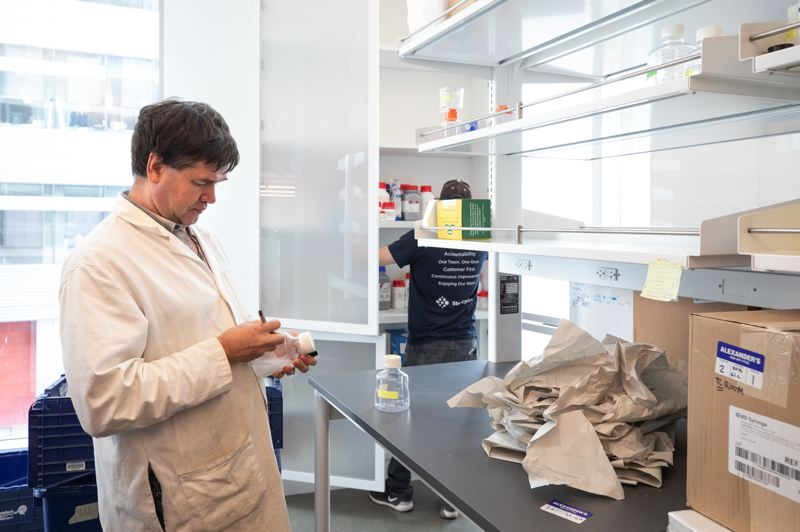 PORTLAND TRIBUNE: JONATHAN HOUSE - Research assistant professor Dmitiri Rozanov unpacks in the wet lab at the Knight Cancer Institute. The tall cupboards and light-filled space are a signature part of SRG Partnership's design.