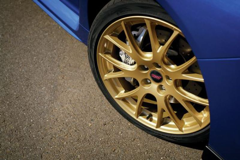 SUBARU NORTH AMERICA - Special gold wheels are open to display the large disc brake on the 2018 Subaru WRX STI Type A.