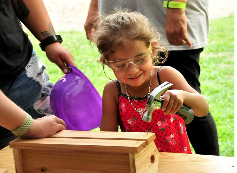 SPOKESMAN PHOTOS: VERN UYETAKE - Alisandra Hernandez works on a planter at one of the kids crafts areas set up at the Wilsonville Summer Block Party.