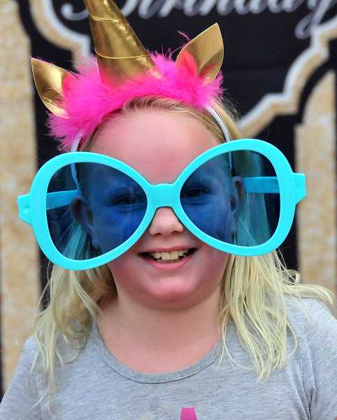 VERN UYETAKE - Courtney Gray of Wilsonville plays up her silly side at a photo booth.