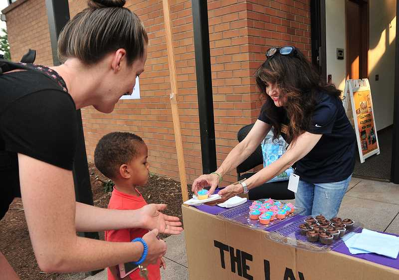 VERN UYETAKE -  City Attorney Barbara Jacobson passes out cupcakes.