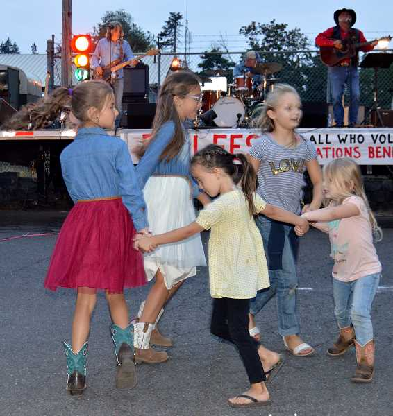 CAROL ROSEN - The youngsters showed the crowd how to have a fun little dance during the evening's entertainment.