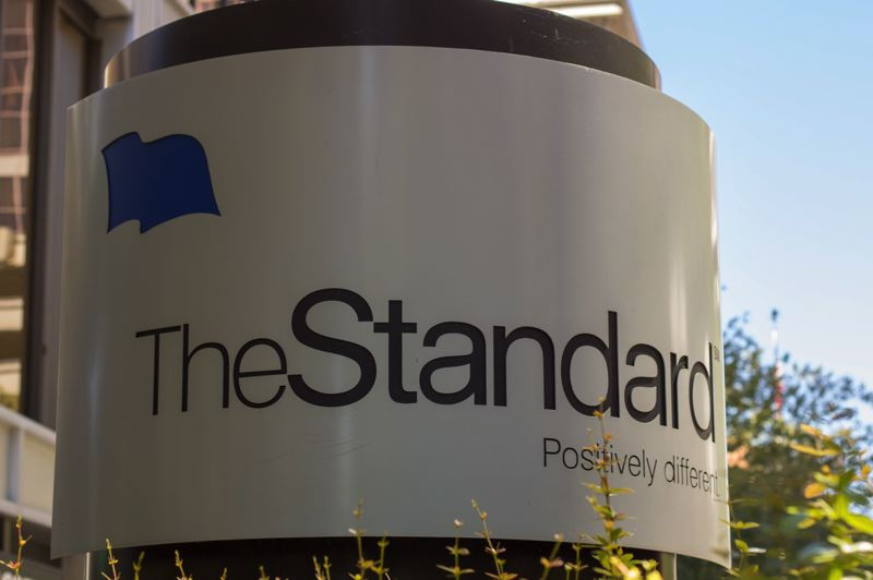 TRIBUNE PHOTO: AINSLIE CROMAR - The Standard Insurance company logo outside the buildings lobby in downtown Portland. The Standard contributed $20,000 to Financial Beginnings newest financial literacy program, Student Academy for Financial Empowerment program.