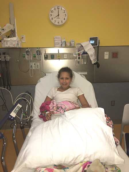 COURTESY: AMY RAMIREZ - Aubryana Ramirez, 10, of Woodburn, is pictured shortly after being admitted to Randall Children's Hospital in Portland, where she is receiving chemotherapy treatments to battle a golf ball-sized cancerous tumor.