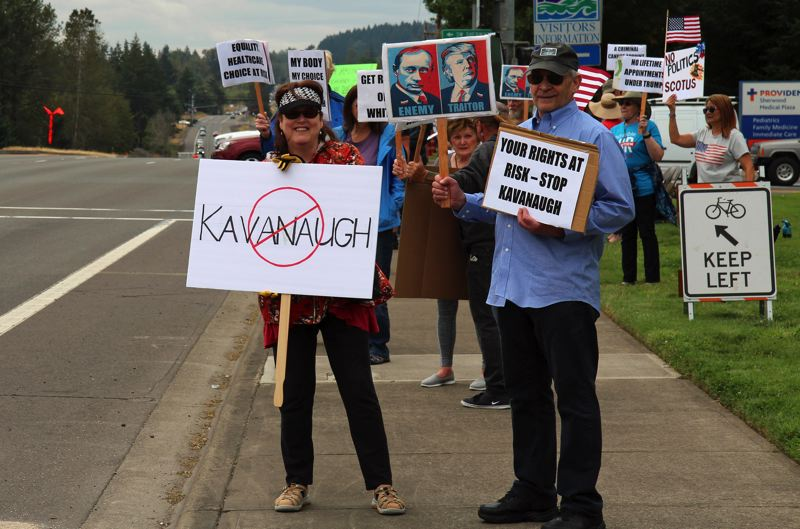 PHOTO: JOEL RUBINSTEIN - Protesters staged a rally in Sherwood on Sunday, to support the investigation into Russian interference in the 2016 election, and to oppose Donald Trump's Supreme Court nominee.