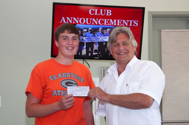 PHOTO COURTESY: LESLIE ROBINETTE - Rotary President Steve Leitz presents Gladstone High School graduate Andrew Prom with a $1,500 scholarship from the Gladstone/Oak Lodge Rotary. Prom plans to attend Oregon State University this fall.