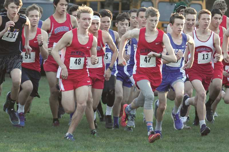 PHIL HAWKINS - Junior Nick Riedman (left) and Luke Hall combine to give the Kennedy boys team one of the top two pairs of distance runners in the district this year.