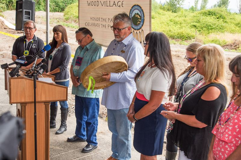 Representatives of the Confederated Tribes of the Grand Ronde Indian Reservation attend an event in July 2016 before the demolition of the former Multnimah Greyhound Park.