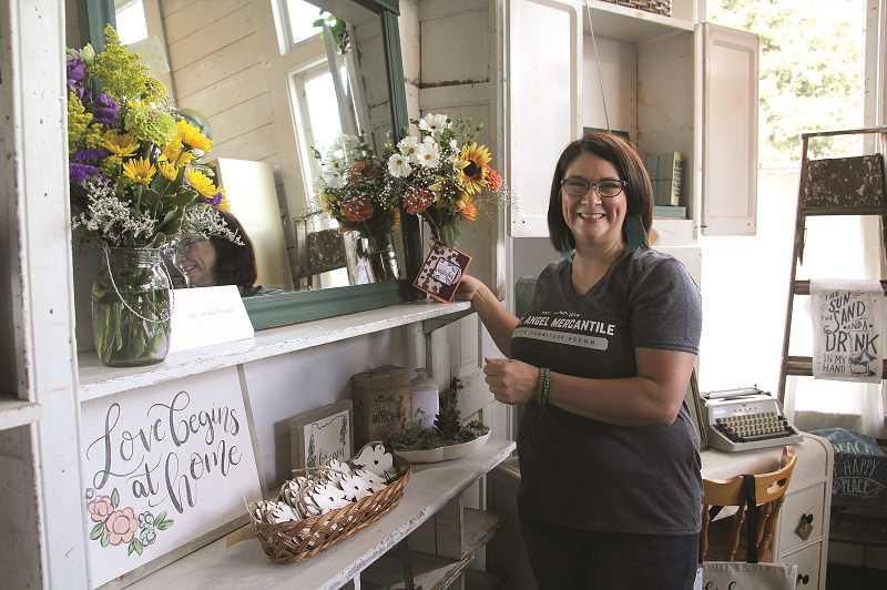LINDSAY KEEFER - Mount Angel Mercantile opened its doors to the public on Friday. Its owner is Mount Angel resident Kelly Grassman, who has been refurbishing furniture and home decor for four years.