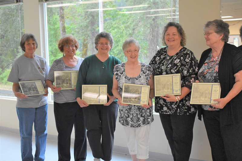 ESTACADA NEWS PHOTO: EMILY LINDSTRAND - The Estacada Community Center's Board of Directors is honored for their service at a reception at the center last weekend.