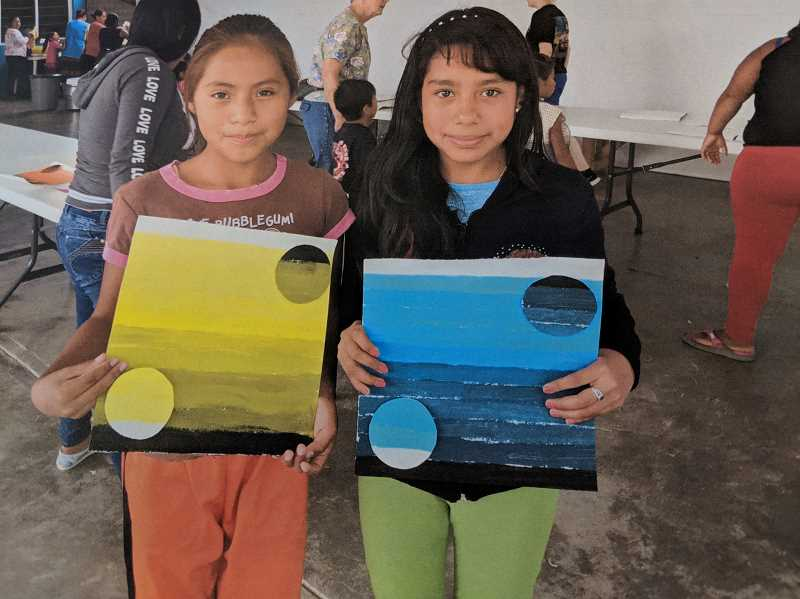 CONTRIBUTED PHOTO: BARTON CHURCH - Two attendees of Trigo y Miel in Oaxaca, Mexico, show the art projects they made with members of the Barton Church mission group.