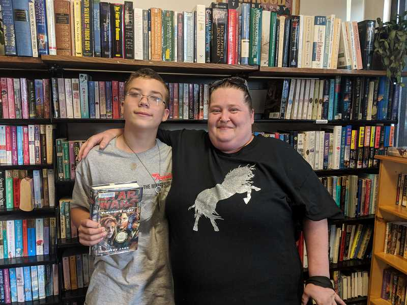 ESTACADA NEWS PHOTO: EMILY LINDSTRAND - Caleb and Sarah Barton visited The Book Nook this summer to find new stories.