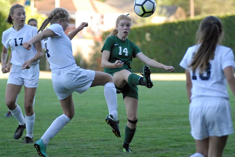 ESTACADA NEWS: MATT RAWLINGS - Katie Willis is able to get a touch on a loose ball in Estacada's draw with Banks on Tuesday.