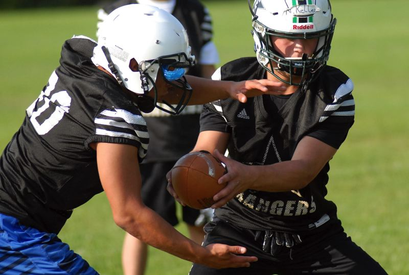 ESTACADA NEWS: MATT RAWLINGS - Estacada QB Nick Keller hands the ball off during practice drills. The Rangers open the season at home Friday against Valley Catholic.