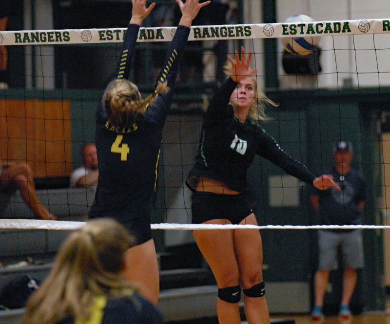 ESTACADA NEWS: MATT RAWLINGS - Trinity Gach's spike attempt goes into the net in Estacada's 3-1 loss to Hood River Valley on Tuesday night.