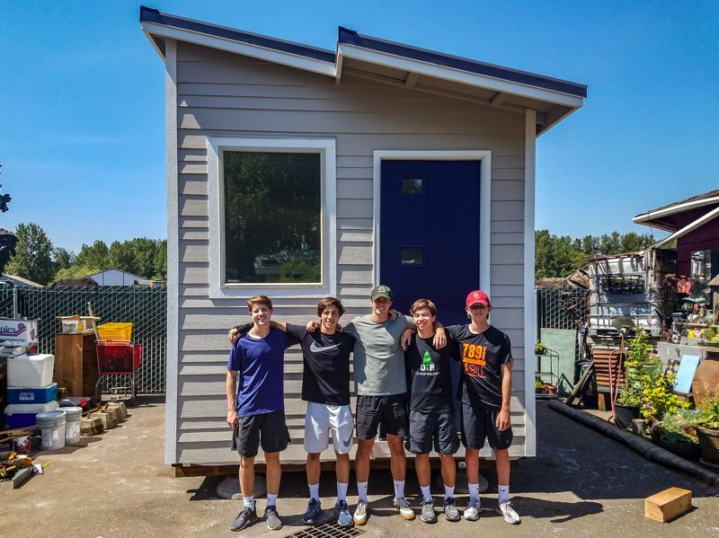COURTESY: STONE BRIDGE HOMES NW - When completed, the tiny house built by Jack and Luke Morissette and other OES students was placed on a flatbed, hauled to Dignity Village and presented to its new tenant.