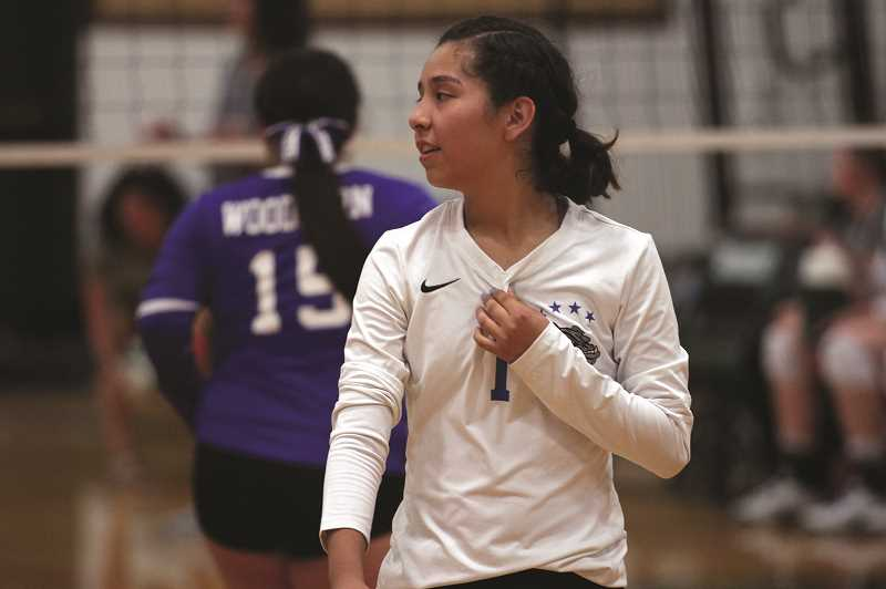 PHIL HAWKINS - Woodburn senior Janet Victoria is one of the few holdovers from last year's team, as the Bulldogs continue to feel out their place in the 4A Classification with a largely new team and coaching staff.