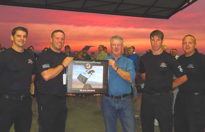 TOM BROWN - The Black Daggers present Joe Krenowicz, center, the air show president, with a signed photo. The four members of the team, who attended the air show kickoff Aug. 23, included, from right to left, Sgt. 1st Class Jason Franey, Sgt. 1st Class Luke Whittington, Sgt. 1st Class Curt Loter, and Staff Sgt. Chris Hardy.