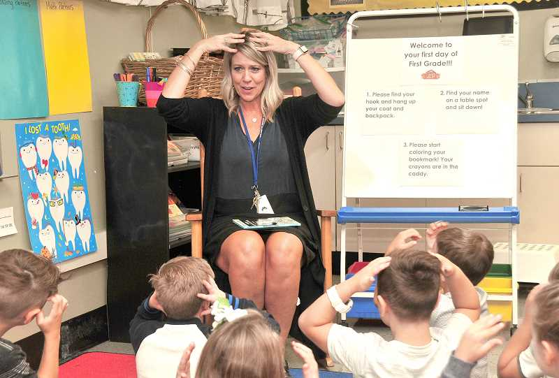 TIDINGS PHOTO: VERN UYETAKE - Willamette Primary first-grade teacher Nancy Fulcher works on getting everyone's attention on the first day of school.