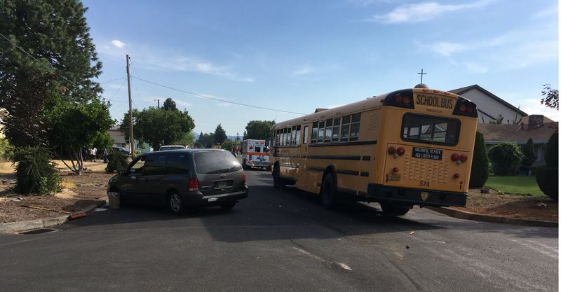 COURTESY PHOTO: WASHINGTON COUNTY SHERIFF'S OFFICE - A Forest Grove school bus and a minivan collided in Cornelius on Wednesday afternoon, Aug. 29, leaving two students and the minivan's driver with what law enforcement called 'minor' injuries.