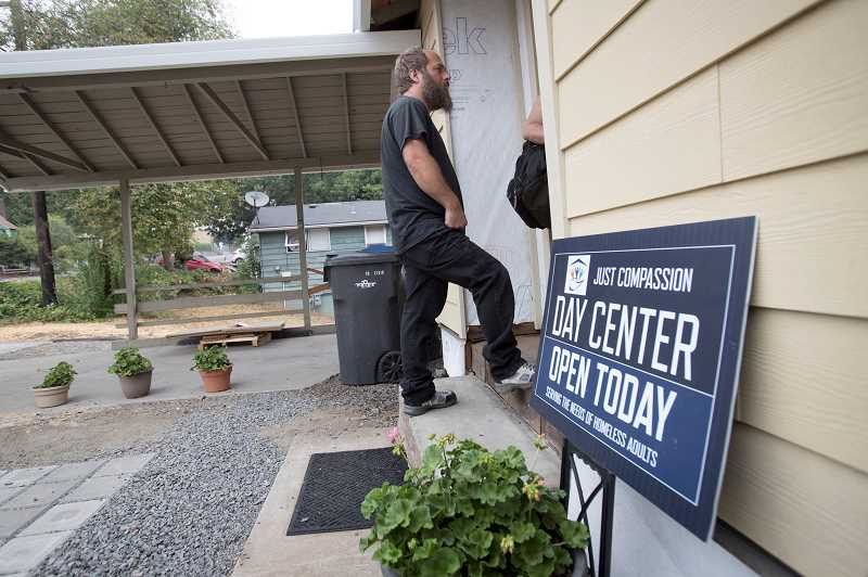 TIMES PHOTO: JAIME VALDEZ - Troy Rowles waits in line to enter Just Compassion Resource Center. Rowles helped refinished the wooden floors at the homeless shelter in Tigard.