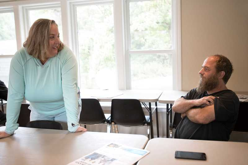 TIMES PHOTO: JAIME VALDEZ - Good Neighbor Center Executive Director Renee Brouse visits with Troy Rowles at the Just Compassion Resource Center in Tigard.