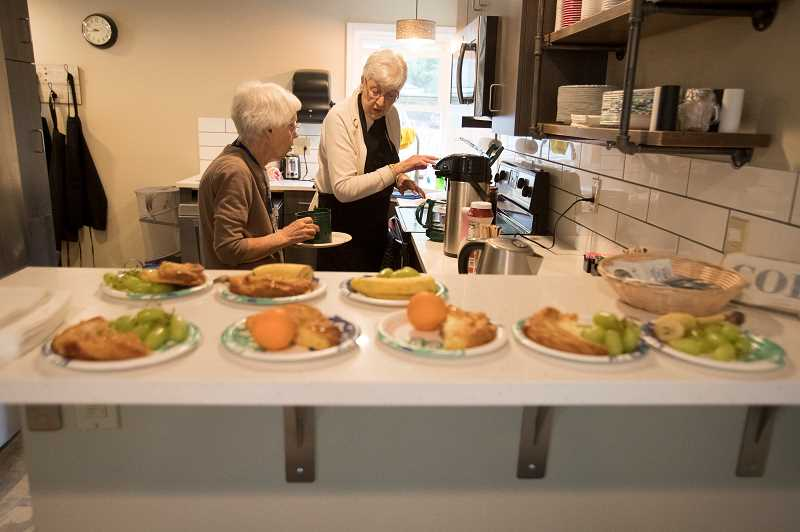 TIMES PHOTO: JAIME VALDEZ - Volunteers help out with breakfast during at recent Thursday at the Just Compassion Resource Center.