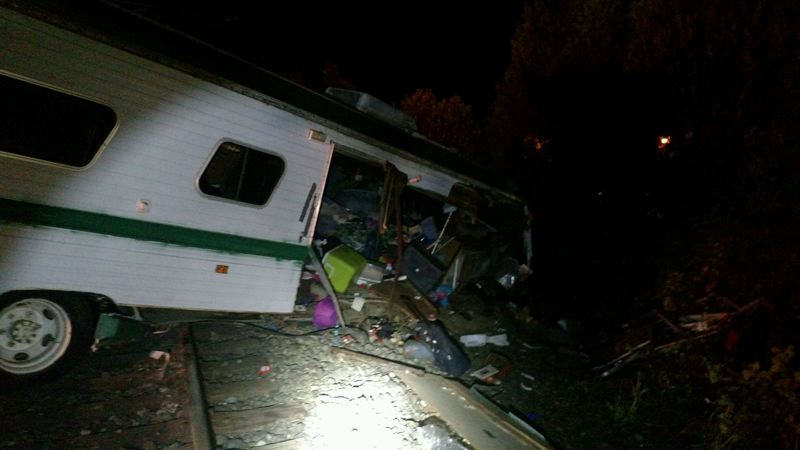 PHOTO COURTESY: MILWAUKIE POLICE - Multiple tow companies were needed to clear the motorhome and wreckage from the tracks.