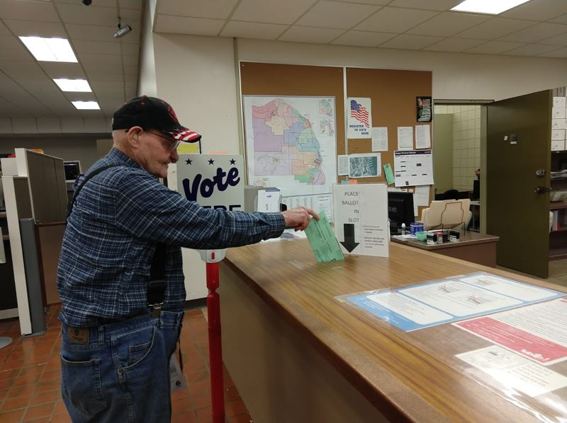 SPOTLIGHT FILE PHOTO - Samuel Todd of Rainier drops off a ballot at the Columbia County Courthouse before the 2018 May primary election. This November, voters will select candidates for county, city and district positions.