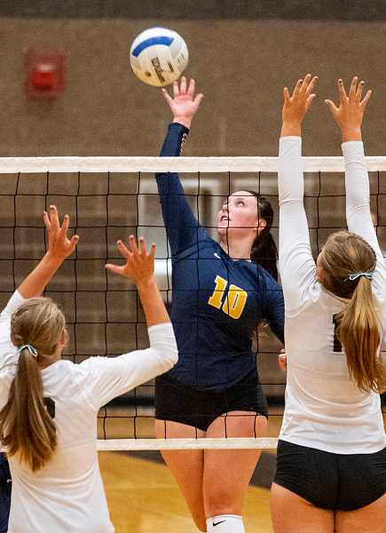 LON AUSTIN/CENTRAL OREGONIAN - Kerigan Waibel goes up for one of her 14 kills against Sisters Tuesday night. Waibel is one of the Cowgirls' team captains and one of just two seniors on the roster. Crook County won the match 3-1.