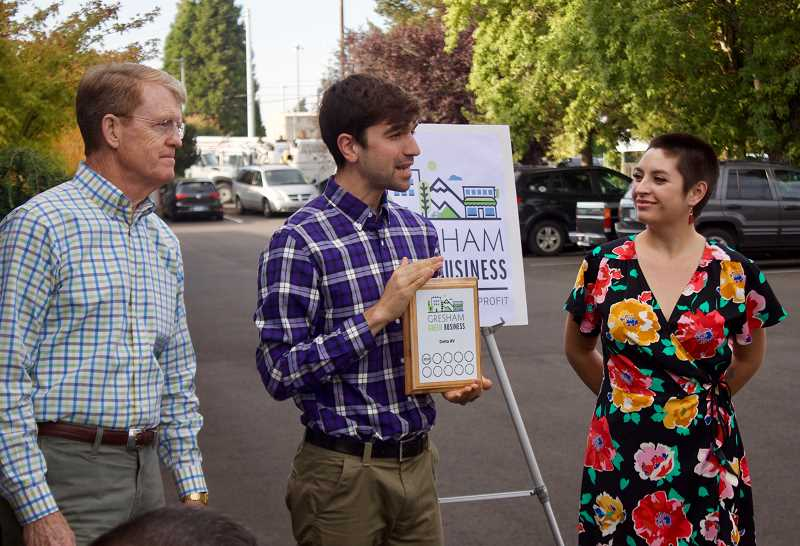 OUTLOOK PHOTO: CHRISTOPHER KEIZUR - Nick Isbister, middle, presents Delta AV with the newly rebranded Gresham Green Business award.