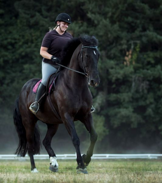 PORTLAND TRIBUNE: JAIME VALDEZ - Taryn McAllister, director of the Lake Oswego Hunt Club, rides Zeus, a former member of the Mounted PatrolUnit, on the property. McAllister adopted him when the unit disbanded in 2017.