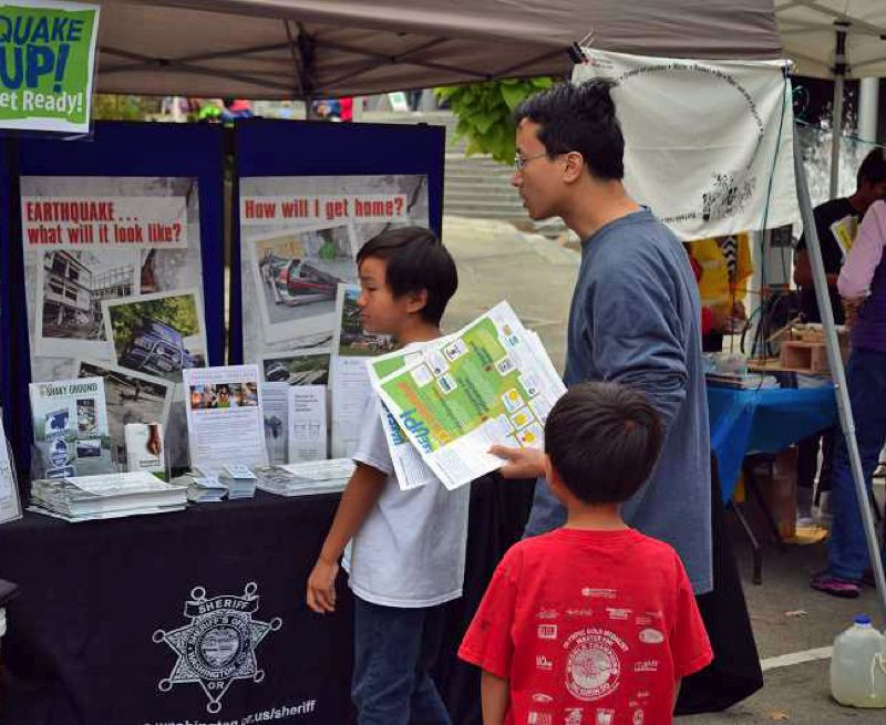FILE PHOTO - Area residents read up on safety materials at a past Quake Up! in Hillsboro.