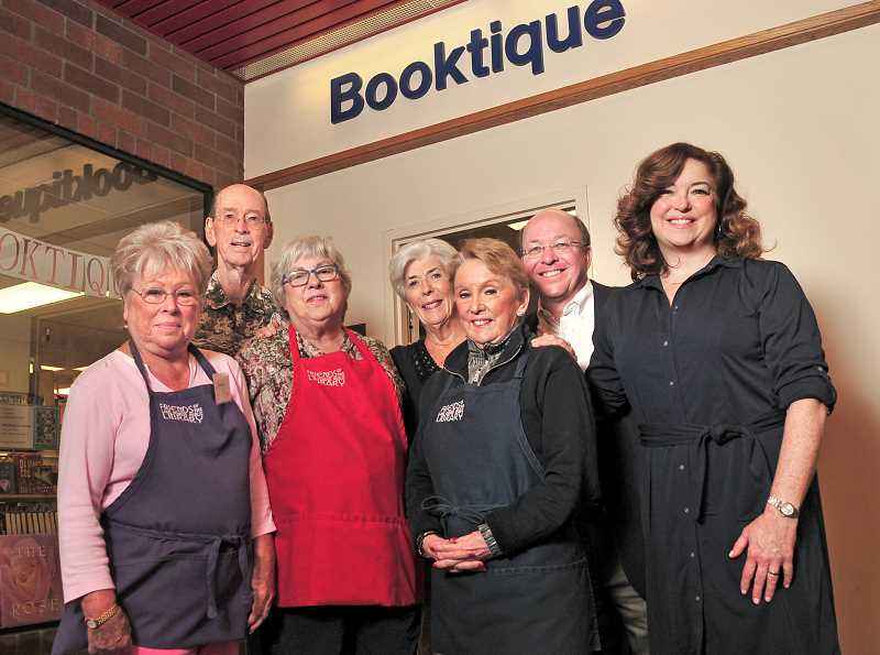REVIEW PHOTO: VERN UYETAKE - Booktique is operated by the Friends of the Lake Oswego Library and is staffed almost entirely by volunteers, including (from left) Rhonda Allen, Leroy Swanner, Barbara Gold and Essie Smith. They're joined here by Library Director Bill Baars and Nancy Niland, president of the Friends group,