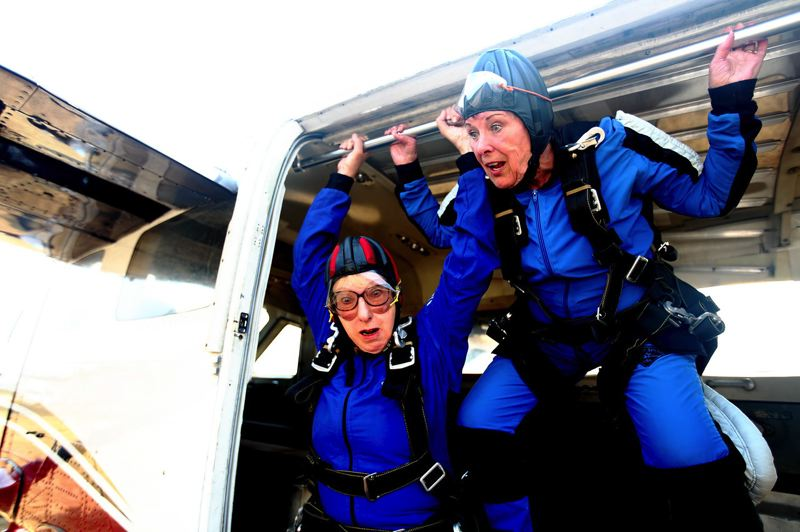 PHOTO BY TRAVIS NODURFT - Marilyn, played by Anita Sorel, hopes to scare Abby, played by Randi Douglas, member of Actors Equity Union, as they get ready to skydive in 'Ripcord.'