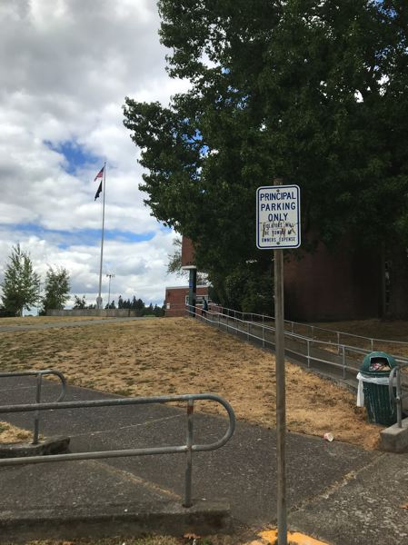 TRIBUNE PHOTO: SHASTA KEARNS MOORE - The principal parking spot at Wilson High School was empty Friday afternoon.