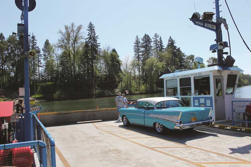 HERALD PHOTO: KRISTEN WOHLERS - The Canby Ferry is about to start it's journey across the Willamette River.