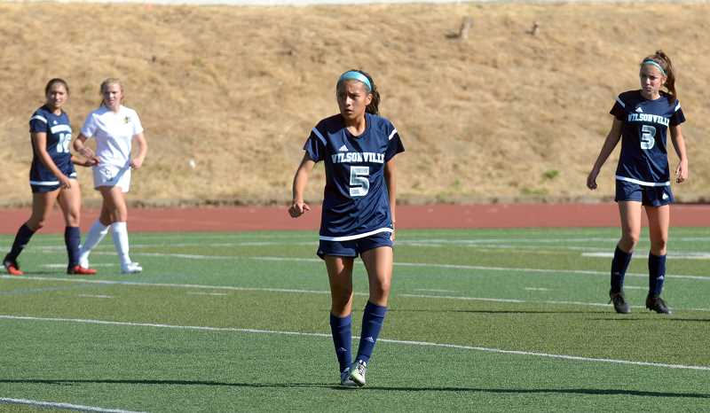 SPOKESMAN PHOTO: TANNER RUSS - Junior midfielder Araxi Tejeda-Martinez had one of two goals for Wilsonville, putting the ball past the Bend keeper in the second half. Wilsonville ended up falling to Bend 6-2 Tuesday, August 28.