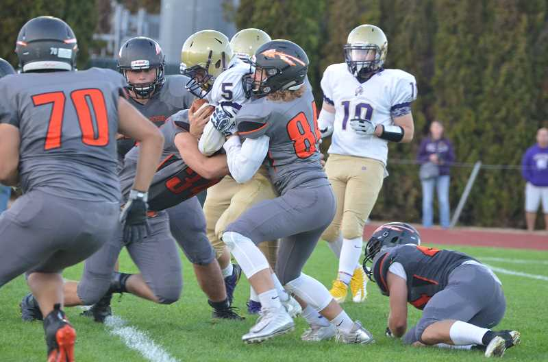 JOHN BREWINGTON - Scappoose's defense was stingy all night. They held Astoria scoreless and the fighting Fishermen had trouble moving the ball until late in the game. Both teams were troubled by penalties as Scappoose persevered to win 27-0.