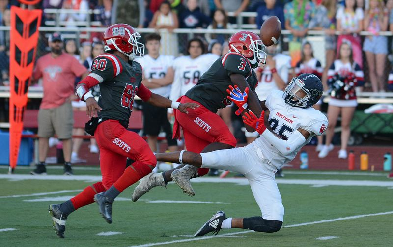 OUTLOOK PHOTO: DAVID BALL - Westview's London Smalley tries to make an acrobatic catch during his team's 578-28 win at David Douglas on Friday night.