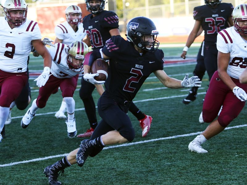 TIMES PHOTO: DAN BROOD - Tualatin senior cornerback Caden Dickson heads up field after intercepting a Southridge pass during the first quarter of Friday's game.