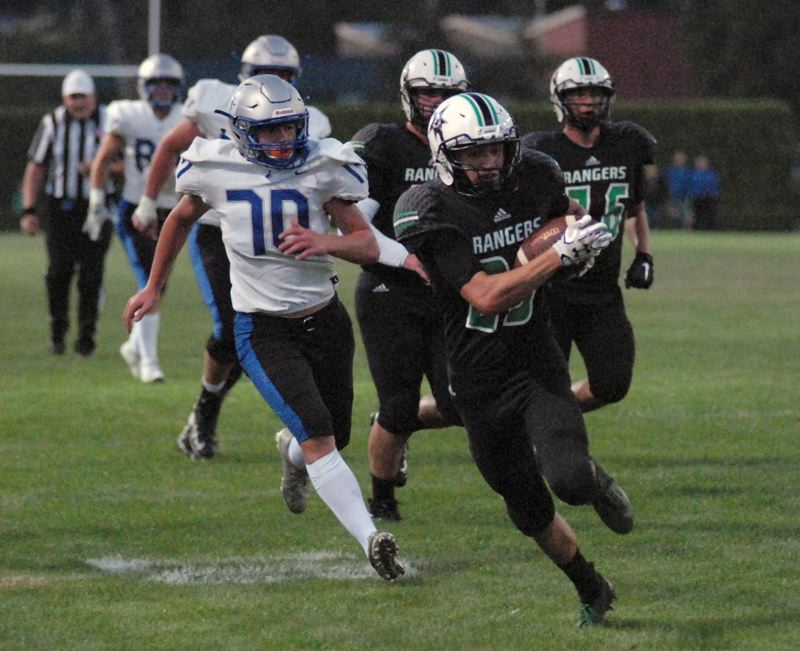 ESTACADA NEWS: MATT RAWLINGS - Logan Stamm breaks away from Valley Catholic defenders for the 25-yard touchdown in the second quarter of Estacada's 28-21 win on Friday.