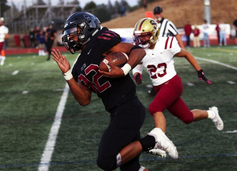 TIMES PHOTO: DAN BROOD - Tualatin senior running back Dominique Loggins is sprinting to the end zone for a touchdown in the Wolves' 47-7 win over Southridge.